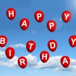Red Balloons In The Sky Spelling Happy Birthday — Stock Photo