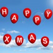 Stock Photo: Red Balloons In Sky Spelling Happy Xmas
