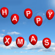 Red Balloons In The Sky Spelling Happy Xmas — Stock Photo