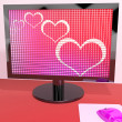 Stock Photo: Hearts On Computer Screen Showing Love And Online Dating