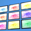 Stock Photo: Nine TV Monitors Wall Mounted In Different Colors Representing H