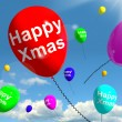 Stock Photo: Balloons Floating In Sky With Happy Xmas