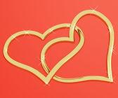 Corazón de oro con forma de anillos que representan el amor y el romance — Foto de Stock
