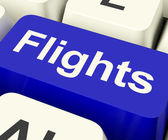 Flights Key In Blue For Overseas Vacation Or Holiday — Stock Photo