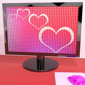 Hearts On Computer Screen Showing Love And Online Dating — Stock Photo