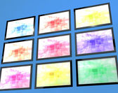 Nine TV Monitors Wall Mounted In Different Colors Representing H — Stock Photo