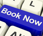 Blue Book Now Key For Hotel Or Flight Reservation Online — Stock Photo