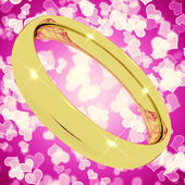 Gold Ring On Pink Heart Bokeh Background Representing Love Valen — Stock Photo