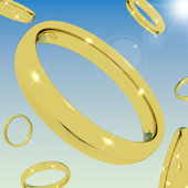 Gold Rings Falling From the Sky Representing Love Engagement Or — Stock Photo