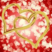 Zlaté srdce ve tvaru kruhů na červené bokeh představující lásku a římské — Stock fotografie