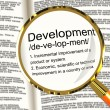 Stock Photo: Development Definition Magnifier Showing Improvement Growth Or A