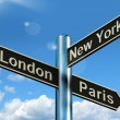 Stock Photo: London Paris New York Signpost Showing Travel Tourism And Destin