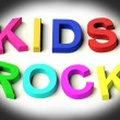 Letters Spelling Kids Rock As Symbol for Childhood And Children — Stock Photo #8052390