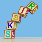 Blocks Spelling Risks Falling Over As Symbol for Danger Or Chanc — Stock Photo