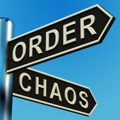 Order Or Chaos Directions On A Signpost — Stock Photo