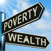 Direções de pobreza ou riqueza em uma placa de sinalização — Foto Stock