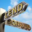 Stock Photo: Lend Or Borrow Directions On Signpost