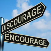 Discourage Or Encourage Directions On A Signpost — Stock Photo