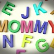 Mommy Written In Plastic Kids Letters — Stock Photo #8136194