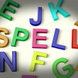 Spell Written In Plastic Kids Letters — Stock Photo