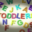 Toddlers Written In Plastic Kids Letters — Stock Photo