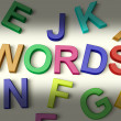 Words Written In Plastic Kids Letters — Stock Photo