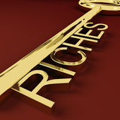 Riches Key Representing Wealth and Treasure — Stock Photo