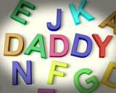 Daddy Written In Plastic Kids Letters — Stock Photo