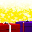Red And Blue Gift Boxes With Yellow Bokeh Background As Presents — Stock Photo