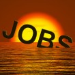 Jobs Word Sinking Showing Layoffs And Unemployment — Stock Photo