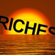 Riches Word Sinking Showing Difficulty Getting Rich — Stock Photo