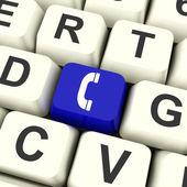 Combiné icône ordinateur bleu clé pour helpdesk ou assistance — Photo