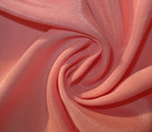 Twisted dull peachy fabric — Stock Photo