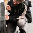 Stockfoto: Young man repairing car