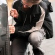 Stock Photo: Young man repairing car