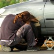 Stock Photo: Young man repairing the car