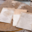 Old documents on dirty table — Stock Photo