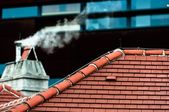Small chimney with smoke — Foto Stock