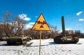 War machines with radioactivity sign at Chernobyl — Stock Photo
