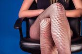 Girl in stockings sitting — Stock Photo