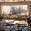 Постер, плакат: Water pouring down on wall in abandoned room in pripyat