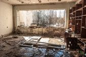 Water pouring down on wall in abandoned room in pripyat — Stock Photo