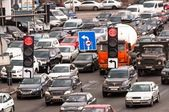 Crowded highway with traffic lamp — Stock Photo
