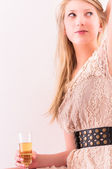 Closeup of a blond girl with champagne — Stock Photo