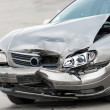 Damaged car on the road — Stock Photo #10583859