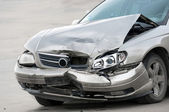 Damaged car on the road — Stock Photo