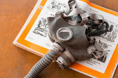 Gasmask on a book for children — Stock Photo