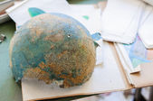 Abandoned and broken globe in a school — Stock Photo
