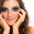 Young beautiful girl with extreme makeup on white isolated backg — Stock Photo