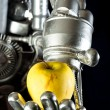 A robot hand with green apple — Stock Photo